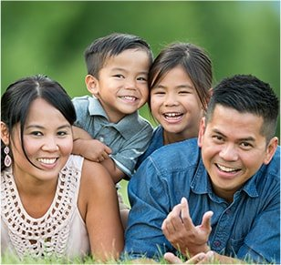 Family smiling after cosmetic dental services