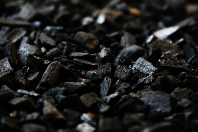 Closeup of a cluster of black activated charcoal that is too abrasive for brushing teeth