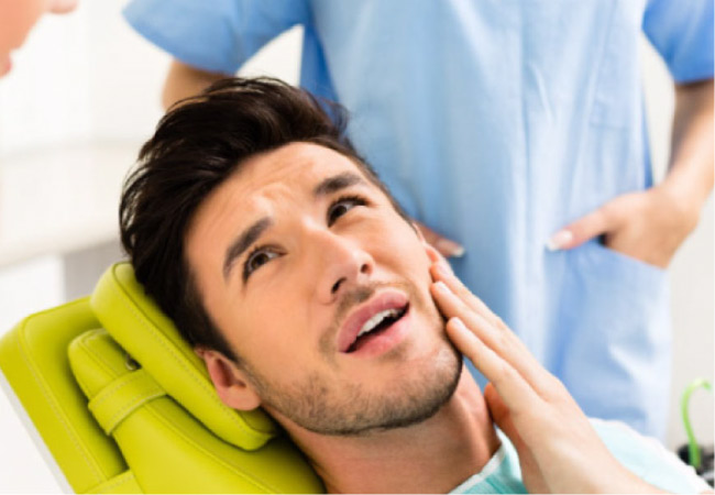 man in the dentist's chair ready for root canal therapy